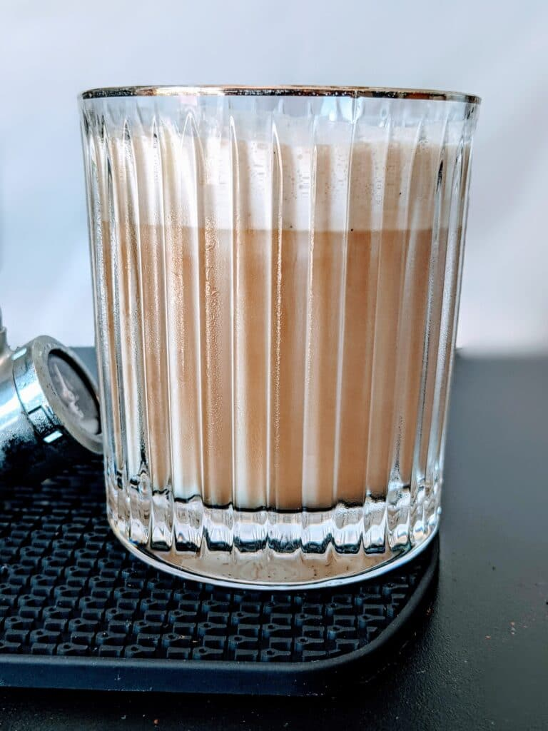 starbucks nitro cold brew with sweet cream in gold rimmed glass