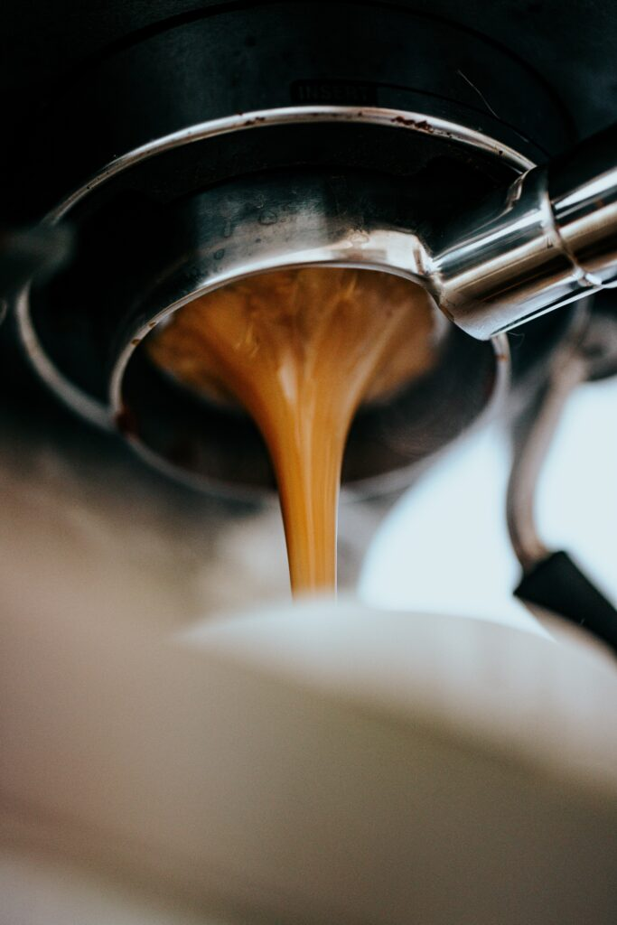 A recipe for starbucks apple crisp macchiato. picture of espresso shot dripping from portafilter