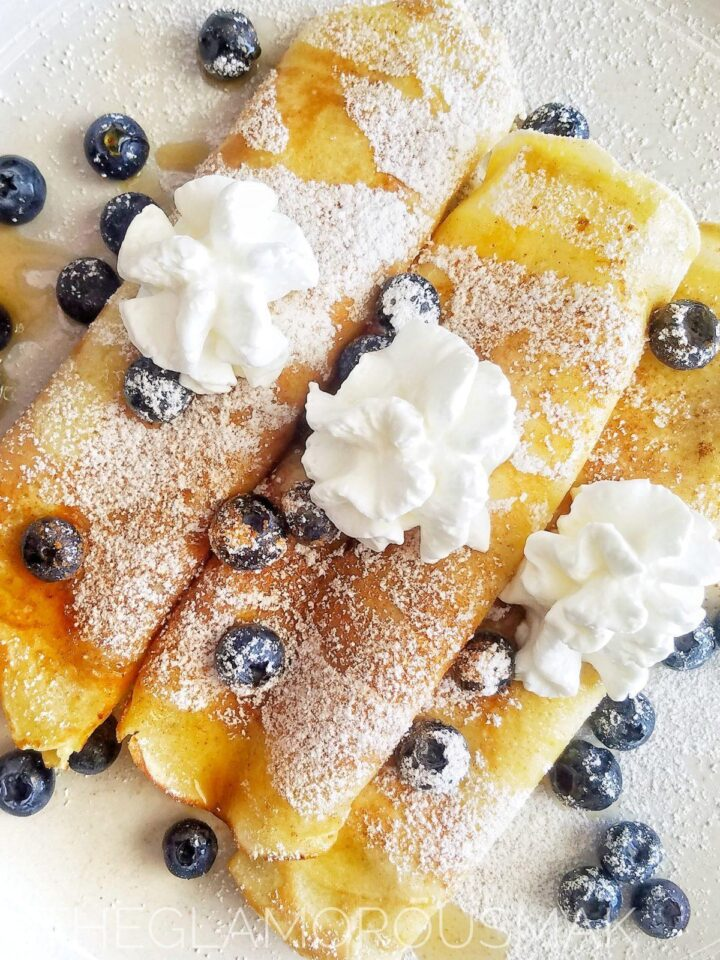 How to make crepes with this simple recipe. With only 5 ingredients this is a quick breakfast, lunch, brunch or dinner. Stuff your crepes with berries, strawberries, blueberries and top with whipped cream and maple syrup. | French, flour, milk, sugar, eggs, how to cook crepes, cast iron pan