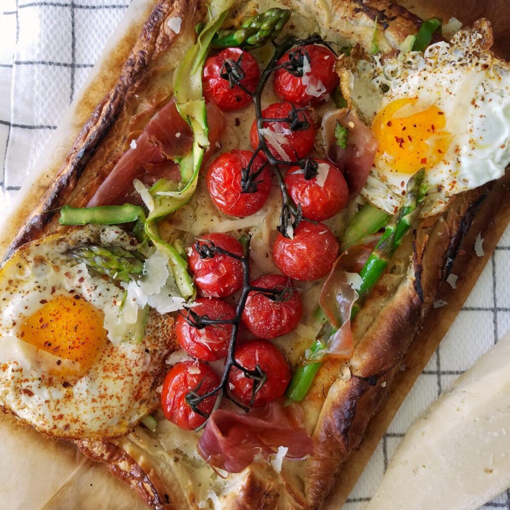 30 minute simple tomato tart.   galette cherry tomatoes shaved asparagus fried eggs puff pastry